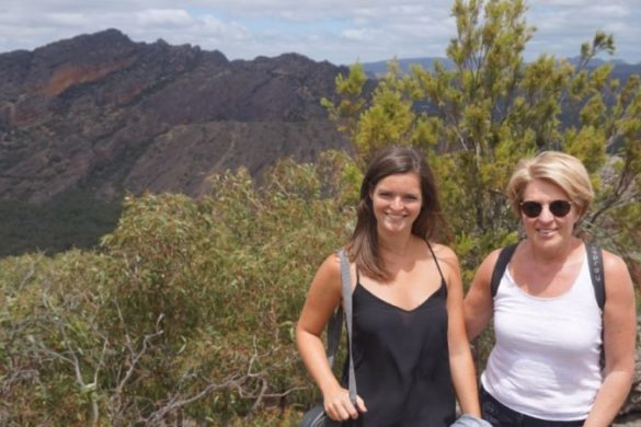Two woman pose in the Australian bush after a hike