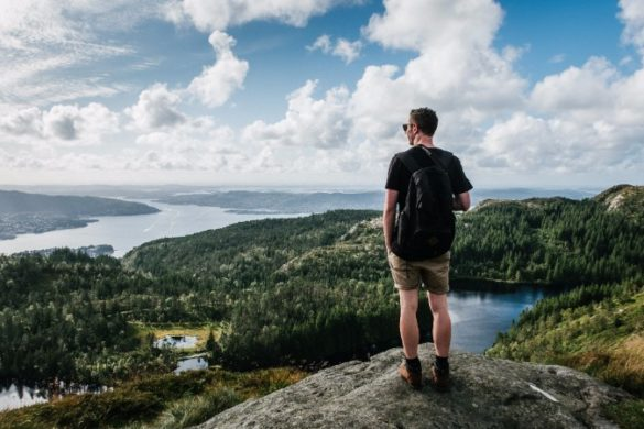 A man looks out over the Norwegian landscape
