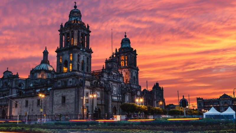 The sun rises over the Mexico City Metropolitan Cathedral in the Zocalo Square in Mexico City
