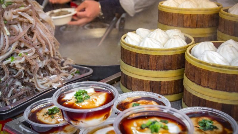 Bowls of tofu and steamed buns