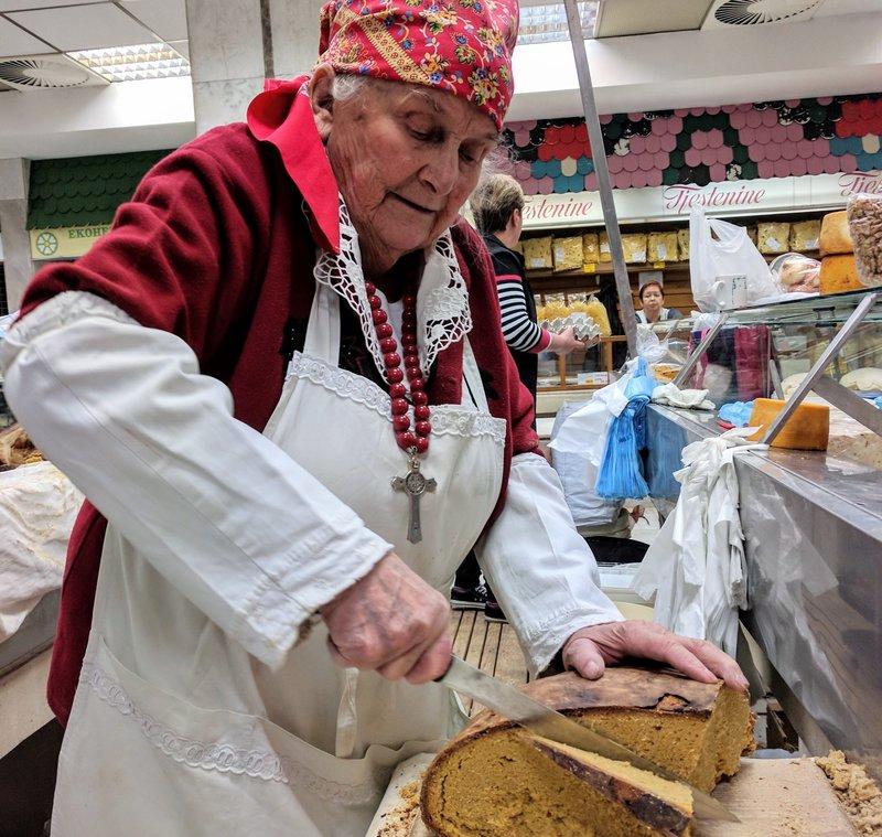 A woman slices cornbread in Croatia