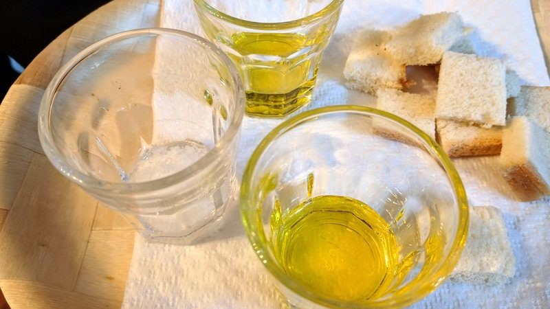 Glasses of olive oil and cubed bread in the market