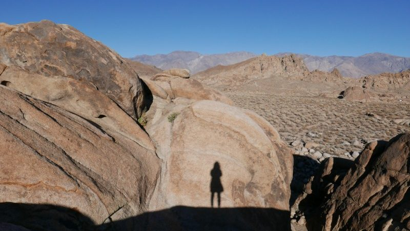 Womans shadow on boulder in Alabama Hills, Lone Pine