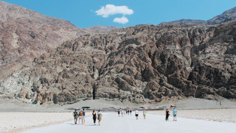 Travellers walk onto the Badwater Basin in Death Valley