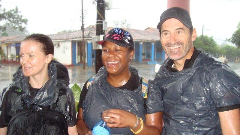 Three travellers wearing garbage bags in the rain