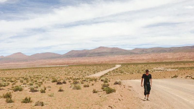 A man walks through the desert in Bolivia