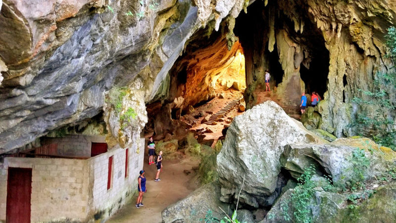 A group of travellers explore a cave in Portales, Cuba