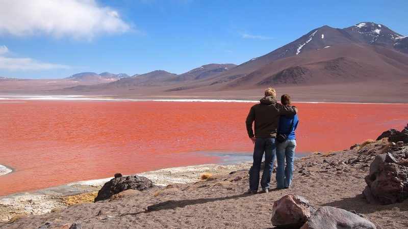 A couple look out over the Laguna Colorada