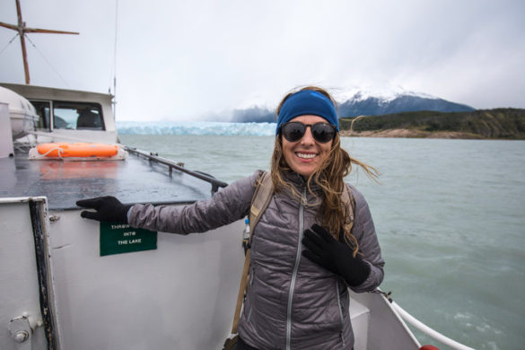 A smiling solo traveller on a boat in Patagonia