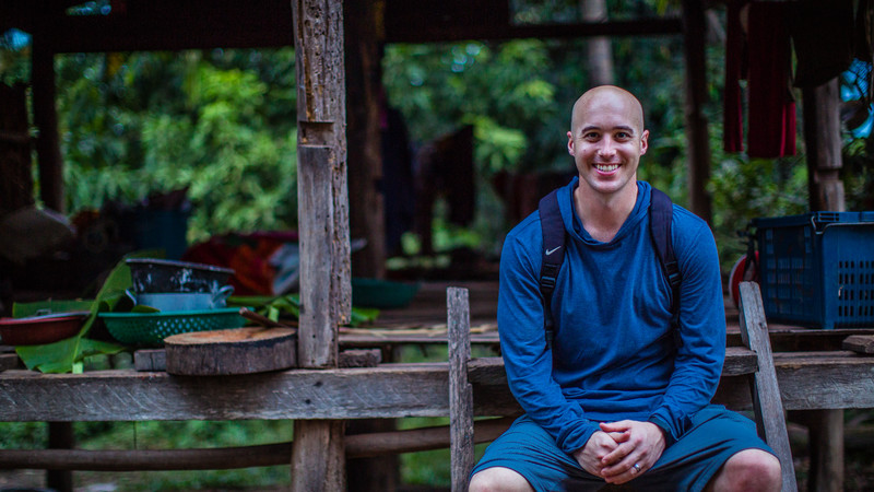 A man smiles for the camera at a homestay in Cambodia