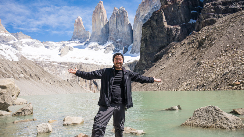 A man stands with his arms outstretched in Patagonia