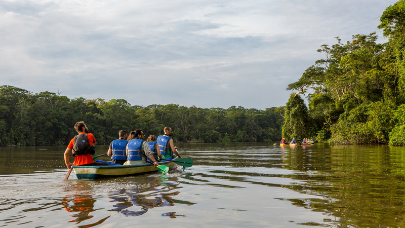 A group of travellers raft along the river in Costa Rica
