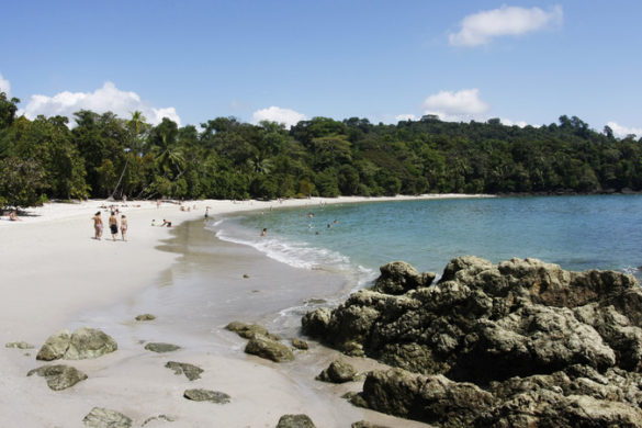 A family play on a beach in Costa Rica