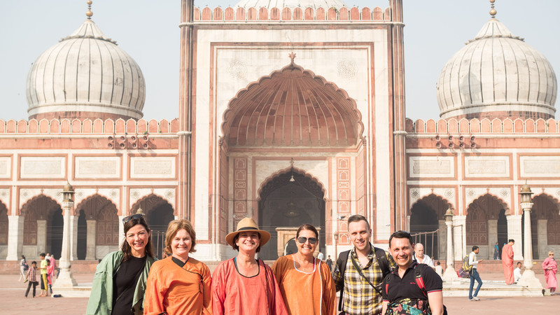 A group of travellers pose in front of the Jama Masjid in India