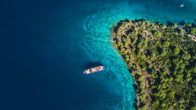 Aerial shot of a small ship cruise in Croatia