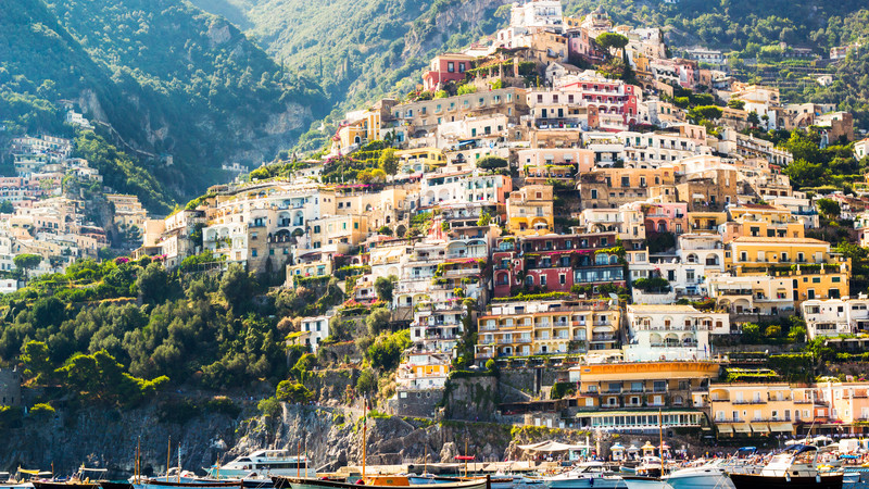 Colourful houses built into the side of a mountain in Positano