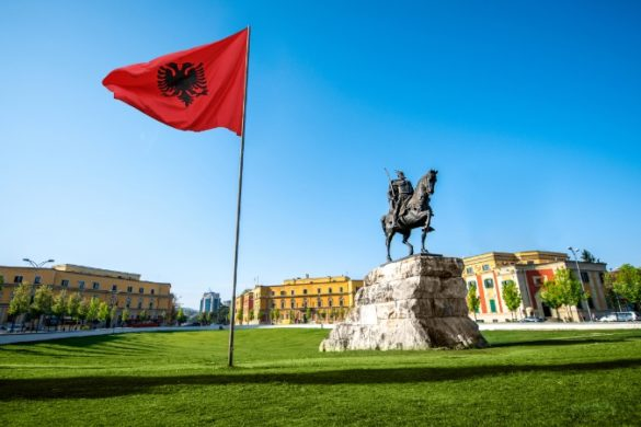 Albanian flag and statue