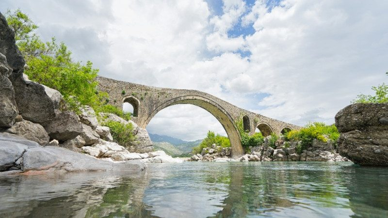 A bridge over a picturesque river in Shkoder, Albania