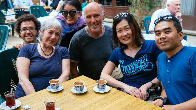 Intrepid group of travellers drinking coffee