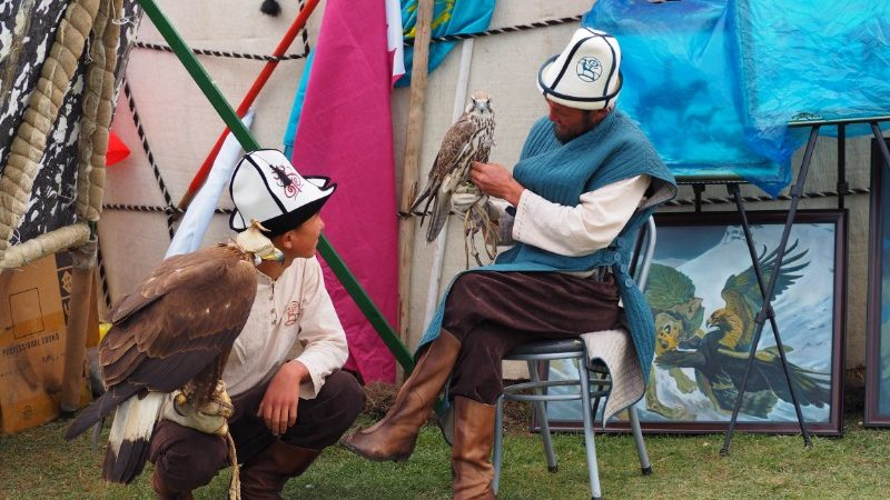Two falconers chat in Kyrgyzstan