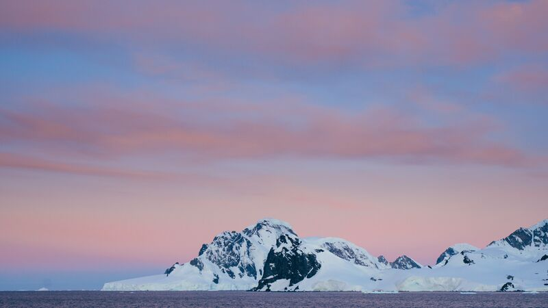 A distant snow-covered mountain in Antarctica