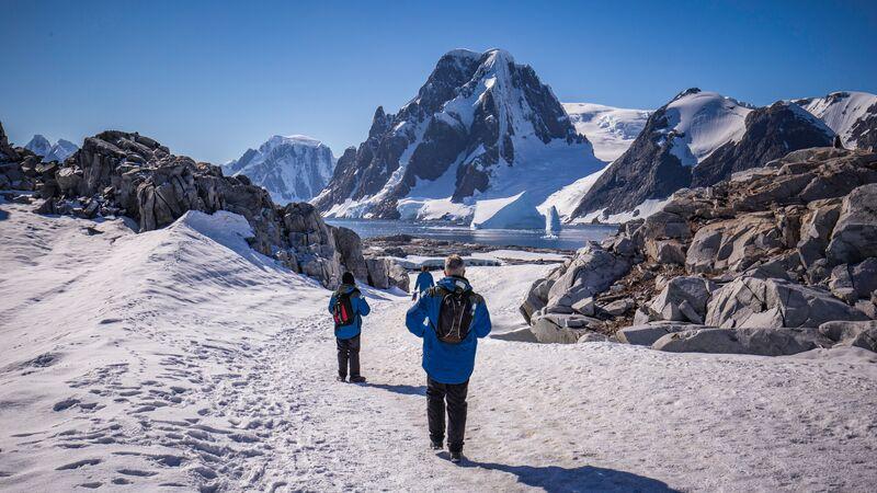 Travellers in trekking through the ice in Antarctica