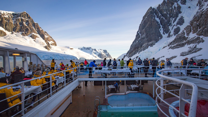 A group of travellers on a ship in Antarctica