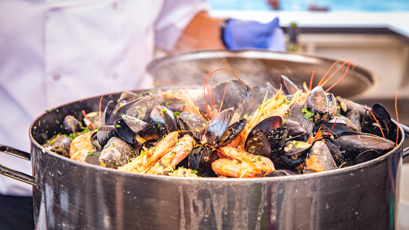Pot filled with fresh mussels and prawns