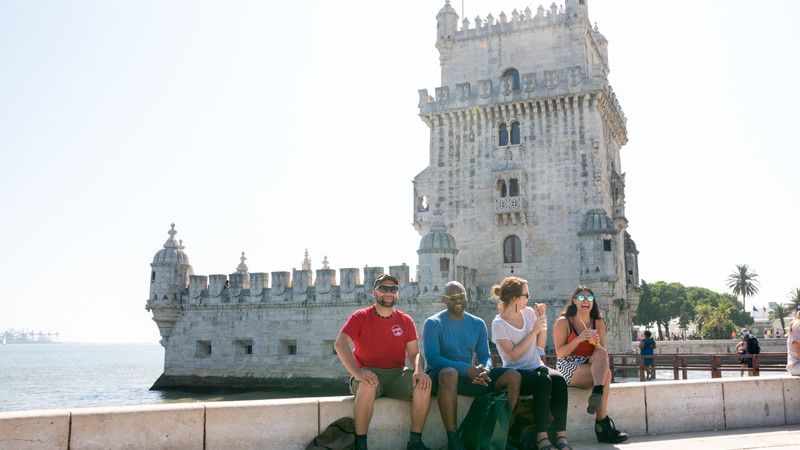 Travellers and a castle in Belem, Portugal