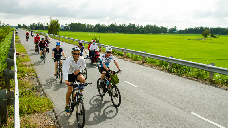 Cyclists on road in Southern Thailand