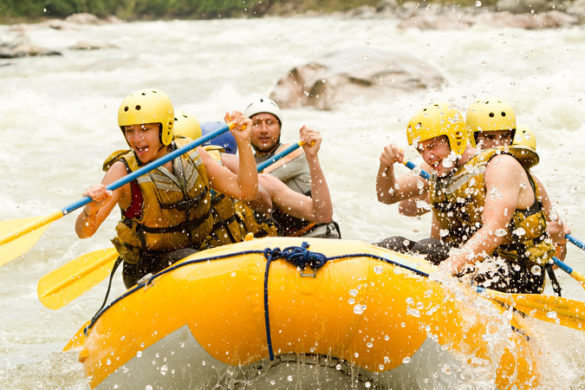 Travellers whitewater rafting in Costa Rica