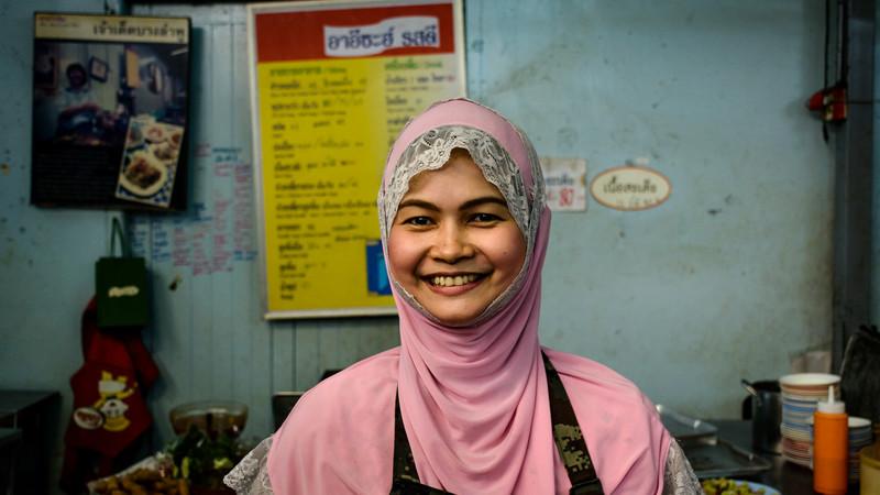 Muslim lady in eatery in Bangkok, Thailand