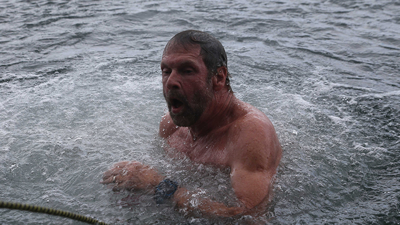 A swimmer resurfaces