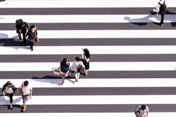 Aerial view of people crossing the road in Japan