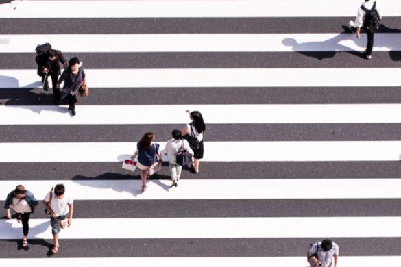 Aerial view of people crossing the road in Japan