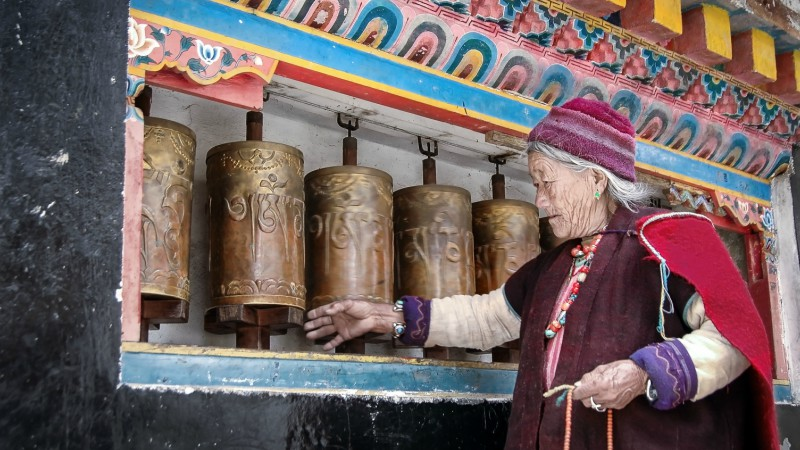 Local Monpa lady prays at the Tawang Monastery