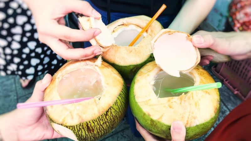 Coconuts with coloured straws in Thailand
