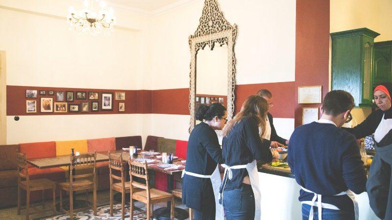Travellers in the kitchen at Beit Sitti