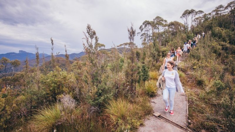 Travellers hiking to Donaghys Lookout, Tasmania