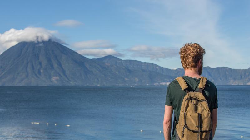 Traveller looks out over Lake Atitlan, Guatemala