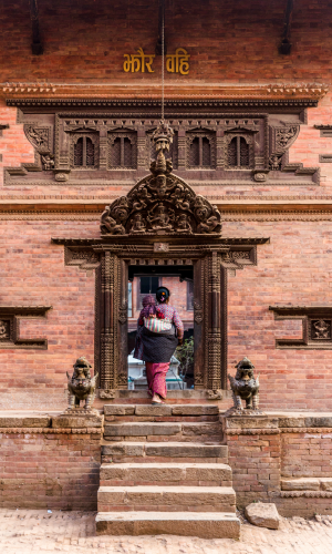 A woman and her baby enter a temple in Bhaktapur, Kathmandu Valley