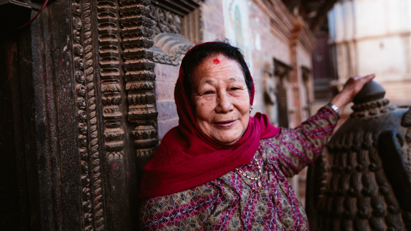 A woman outside a temple in Bhaktapur, Kathmandu Valley