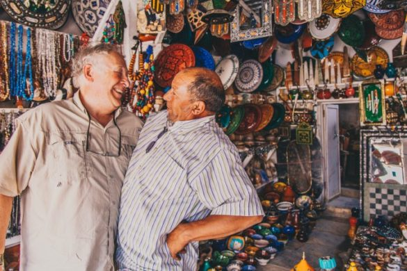 A traveller laughing with a local Moroccan man