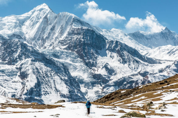 A hiker in front of the Annapurna Mountains on the Annapurna Circuit trek