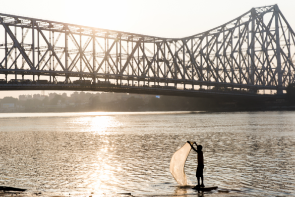 Sun rising over the Howrah Bridge in Kolkata, India