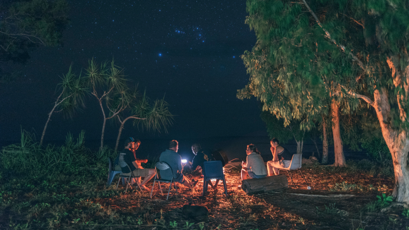 Groups sits under the stars in Arnhem Land, Australia