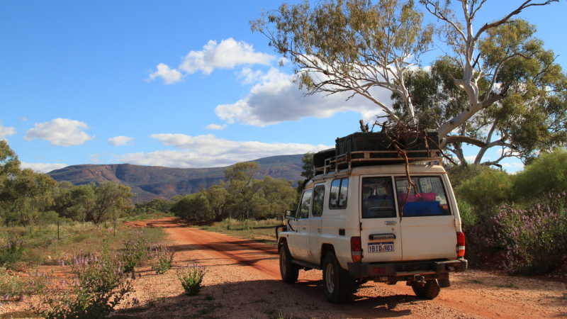 Overland truck on a dirt track by Mount Augustus, Australia