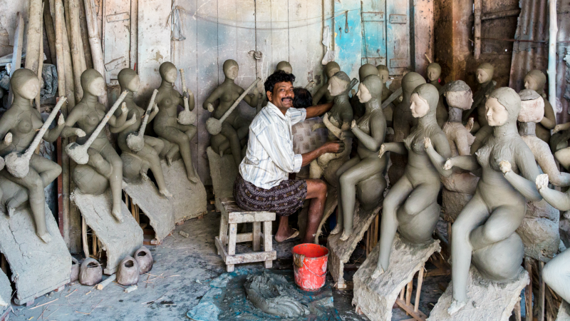 An idol maker in Kumartuli district, Kolkata, India