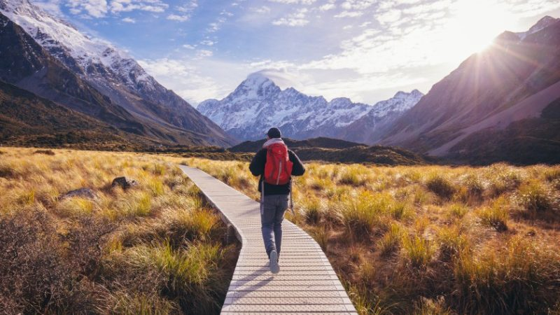 Backpacker walking in mountains in New Zealand