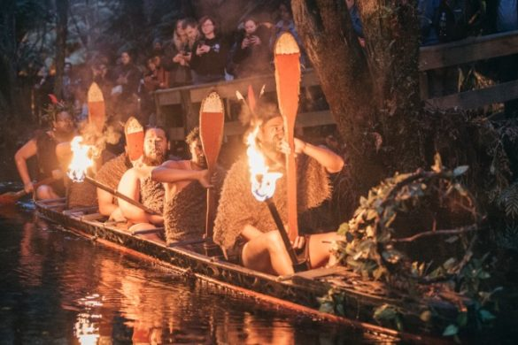 Maori warriors paddling in canoe